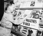 Off-duty soldier browsing the magazine rack at an USO Service Men's Center, Atlanta, Georgia, 1942.