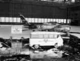 F-84 Thunderstreak fighter-bomber and WBML Mobile Music bus at Robbins air base, Warner Robbins,...