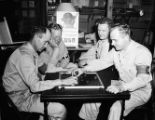 Soldiers playing checkers at a USO Service Men's Center, Atlanta, Georgia, 1942.