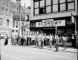 Crowd in front of Economy Auto Store, Whitehall and Mitchell Streets, Atlanta, Georgia, May 19,...