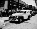 WBGE radio mobile unit automobile, parked outside the Buckhead Department Store. Reporter is...