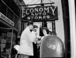 WBGE radio reporter interviewing a woman outside Economy Auto Stores, East Point, Georgia, May 18,...