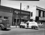 WBGE radio broadcasting van (automobile) outside General Auto Stores building, East Point,...