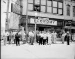 WBGE reporter and crowd outside General Auto Stores building, Whitehall and Mitchell Streets,...