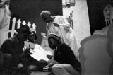 "Men shooting dice, scene from the morality play ""Heaven Bound,"" staged by the Big Bethel..."