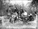 Robert and Nell Woodruff with their guests during a picnic break during a hunting trip, Ichauway...
