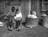 African American and white children sitting in cotton baskets, Pine Mountain Valley, Georgia,...