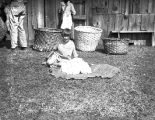 Young girl with a pile of picked cotton, Pine Mountain, Georgia, 1934-1935.