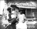 African American family in front of their home.