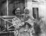 Woman holding a baby, Ichauway Plantation, Baker County, Goergia, 1931.