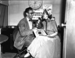 Anita Colby (right) being interviewed by a man from WCON radio station, Atlanta, Georgia, May 11,...