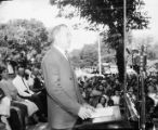 "Man giving speech at the festivities surrounding the 1943 ""Army Navy E Award"" to Aragon..."