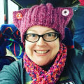 "Kristina Graves on bus wearing ""pussy hat,"" Women's March on Washington, 2017-01-21"