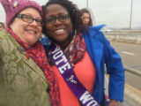 Kristina Graves and friend next to the highway, Women's March on Washington, 2017-01-21