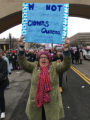 Kristina Graves holding Elizabeth Cady Stanton quote protest sign, Women's March on Washington,...