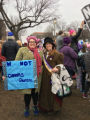 Kristina Graves holding Elizabeth Cady Stanton quote protest sign with a woman in a Nasty Woman...
