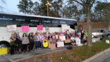 Busload of protesters holding signs, Women's March on Washington, 2017-01-21