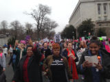 Crowd of protesters marching and carrying signs, Women's March on Washington, 2017-01-21