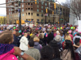 Crowd of protesters marching and holding signs, Atlanta March for Social Justice and Women,...