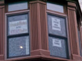 Window with protest signs, Women's March on Washington, 2017-01-21