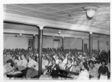 M. H. Ross (bottom left) taking notes during International Union of Mine, Mill, and Smelter...