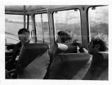 M. H. Ross and others on a bus trip, circa 1970s