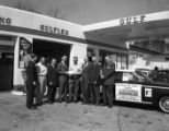 Lempco Automotive employees awarding a check at a Gulf service station, 1963