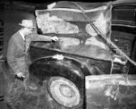Police investigate the pickup truck where the body of Jeanette Reyman was found, 1947