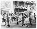 Georgia State University Drill Team and Pershing Rifles marching in a Mardi Gras parade, circa...