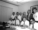 Machinists signing a new union contract, 1962